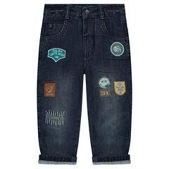 Jeans effet used doublé micropolaire avec badges ©Smiley