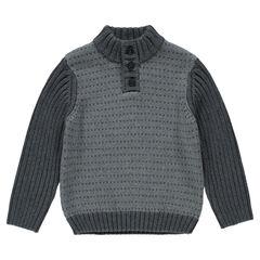 Trui in fantasie tricot opening met knopen