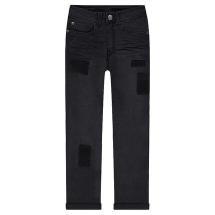 Jeans met used en crinkle effect en gesuggereerde patches