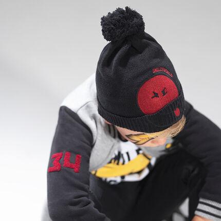 Bonnet en tricot avec pompon et patch ©Smiley en feutrine