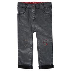 Jeans enduit argenté avec coeurs et message brodés