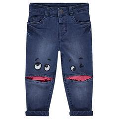 Jeans van used denim gevoerd met jerseystof en met opgestikte ogen