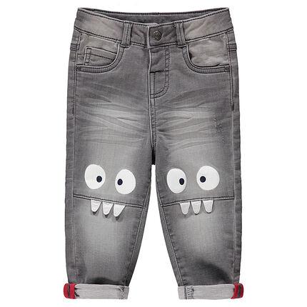 Jean gris effet used et crinkle avec monstres printés sur les genoux
