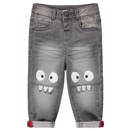 Grijze jeans met used en crinkle-effect met monsterprint aan de knieën
