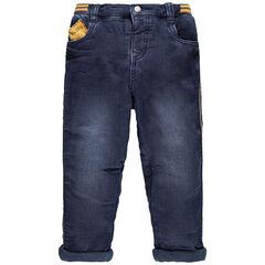 Jeans met used effect en voering van microfleece met gele toetsen