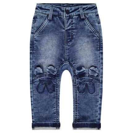 Jeans effet used et crinkle avec oreilles en relief