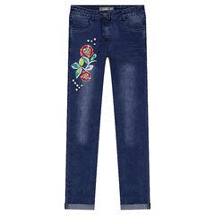 Jeans slim effet used avec fleurs brodées et perles fantaisie