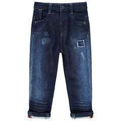 Jean effet used et crinkle à usures et poches