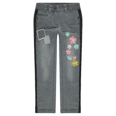 Jeans skinny effet used avec fleurs brodées et galons frangés