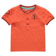 Polo manches courtes en coton orange avec poche et girafe printée