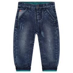 Jeans effet used avec poche printée