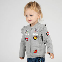 Vest uit molton met volants en ©Smiley badges