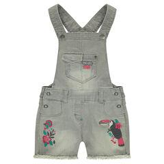 Salopette courte en jeans used avec poches et broderies colorées