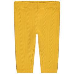 Gele legging met kabelmotief en gouden biezen