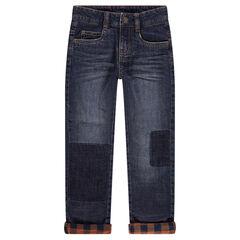 Jeans met used en crinkle-effect en gevoerd met geruite flanel