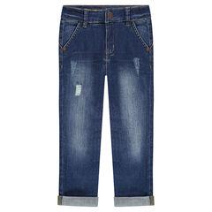 Jeans effet used avec textes printés au dos