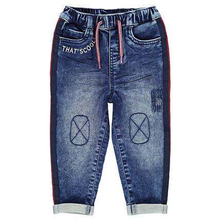 Jeans effet used élastiqué avec bandes contrastées sur les cotés