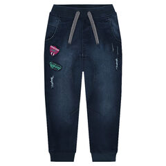 Jeans en molleton effet denim used avec badges