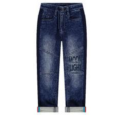 Jeans effet used avec découpes et inscription printée