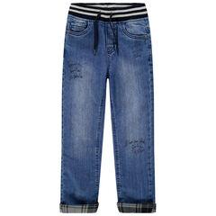 Jeans met used effect, elastische taille en voering van geruit flanel