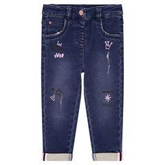 Jeans met used en crinkle-effect, print met gekleurde symbolen