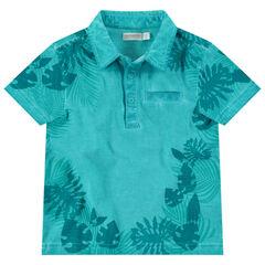 Polo manches courtes en coton surteint à imprimé tropical all-over