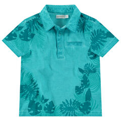 Polo manches courtes en coton surteint à imprimé tropical all-over