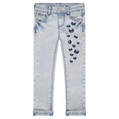 Jeans effet used et crinkle avec noeuds brodés