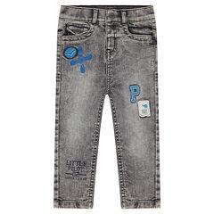 Jeans effet neige used avec badges et prints
