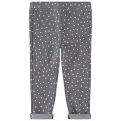 "Jegging met roze stippenprint ""all-over""."