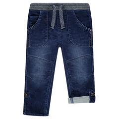 Jeans en denim used souple avec bas des jambes rétractable