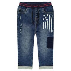 Jeans effet used avec print effet peinture et usures