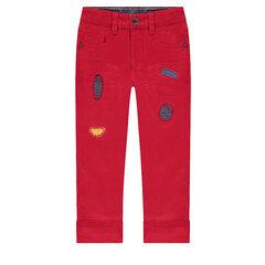 Pantalon rouge avec déchirures fantaisie