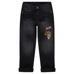 Jeans met used en crinkle effect en voering van jerseystof met tijgerbadge